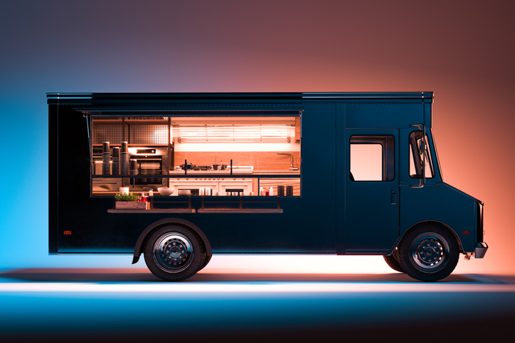 Side View of Black Food Truck With Detailed Interior Isolated on Illuminated Background. Takeaway food. 3d rendering.